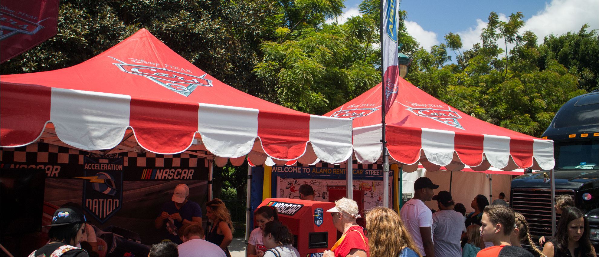 Disney cars 3 custom canopies installed at a tour where people get to interact and learn more about the movie coming up
