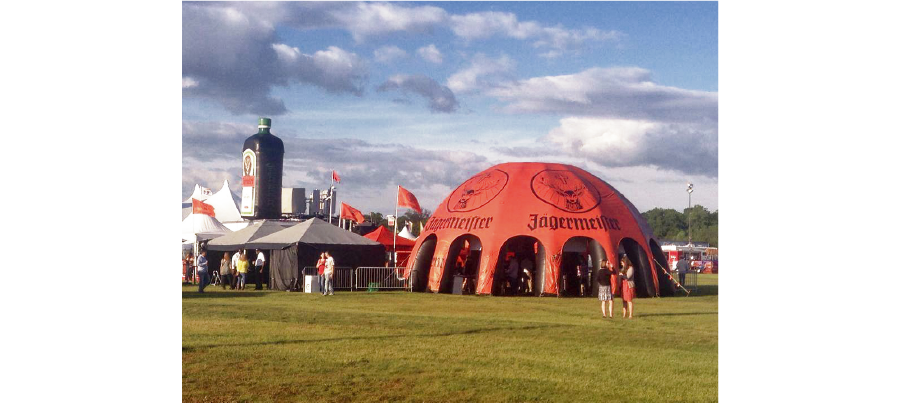 orange jagermeister inflatable dome at a music festival