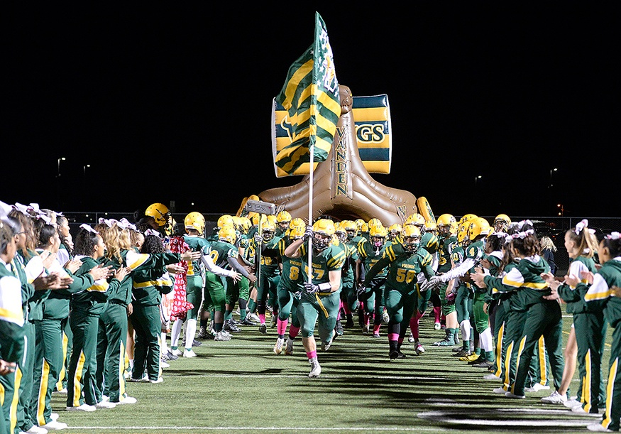 custom viking tunnel with a football team charging out of it at a high school football game