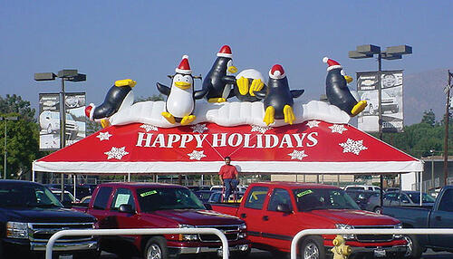 Christmas Inflatables - Large array of giant christmas decorations including a giant Santa Claus.