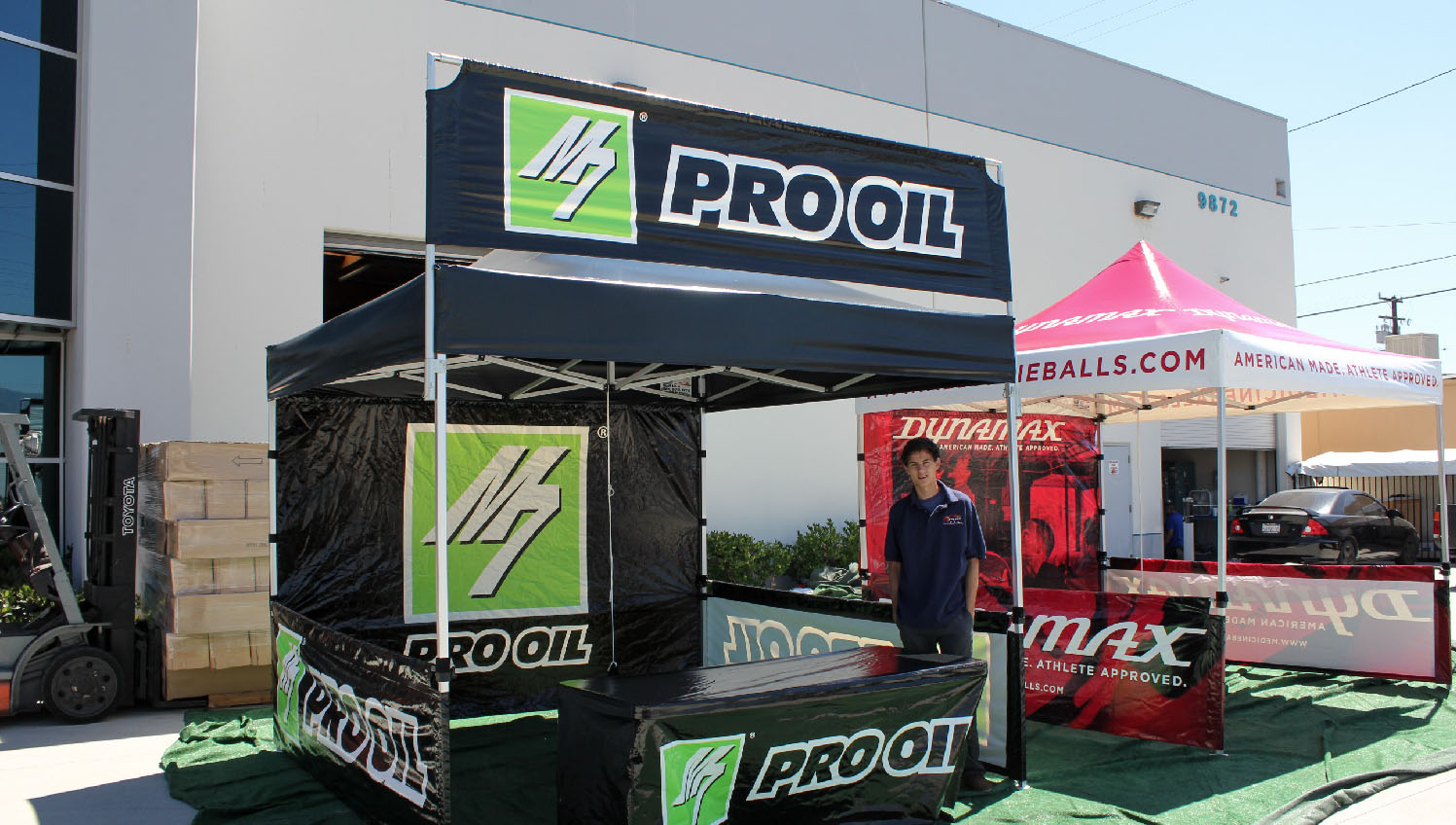 10x10 canopy with a pop up tent banner for Pro Oil