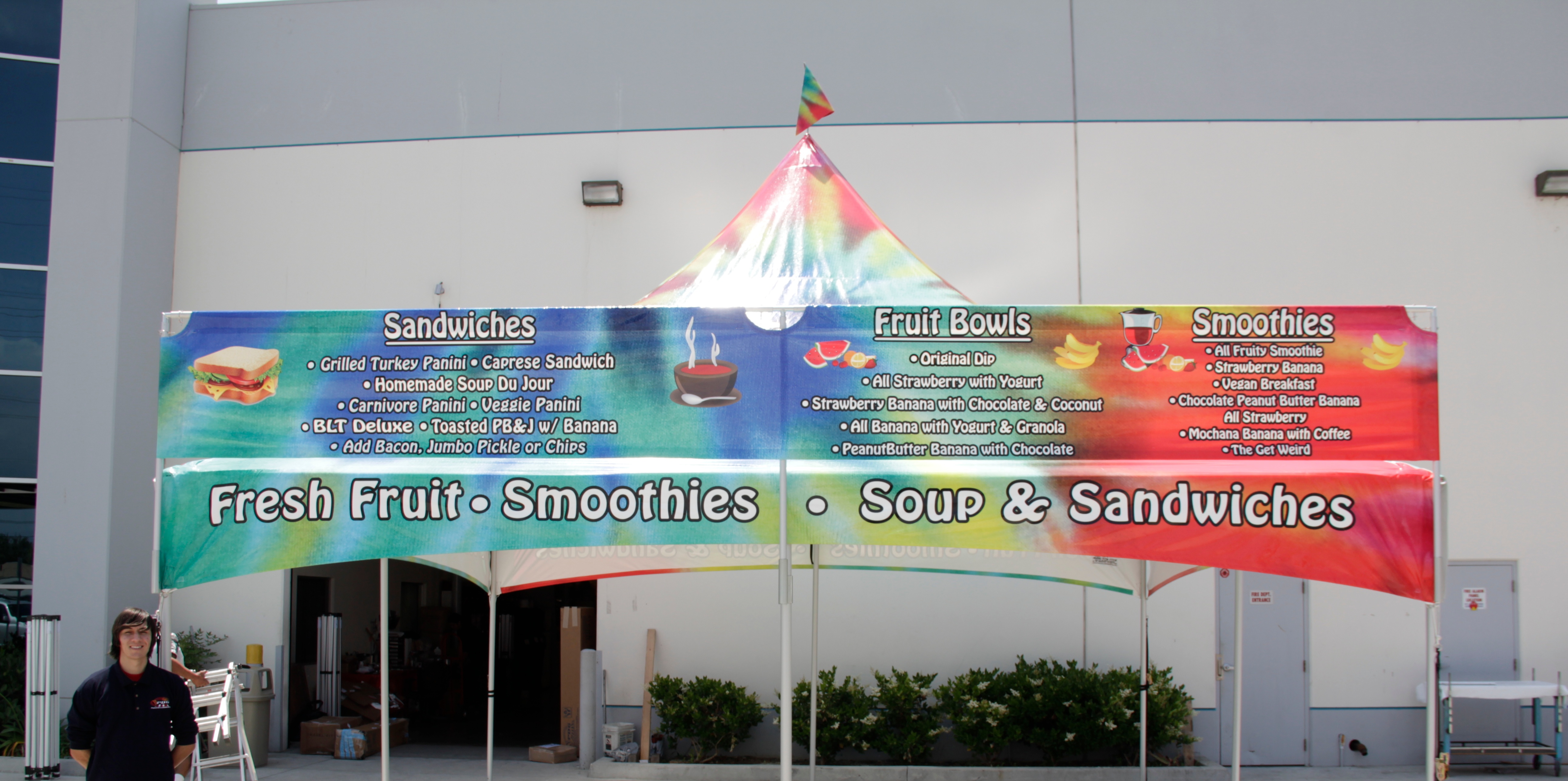 20 foot tent banner used as a menu on top of a high peak tent