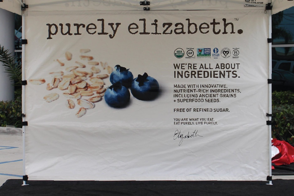 custom printed full back wall with blueberries and seeds of some sort as well as a note talking about quality of the ingredients