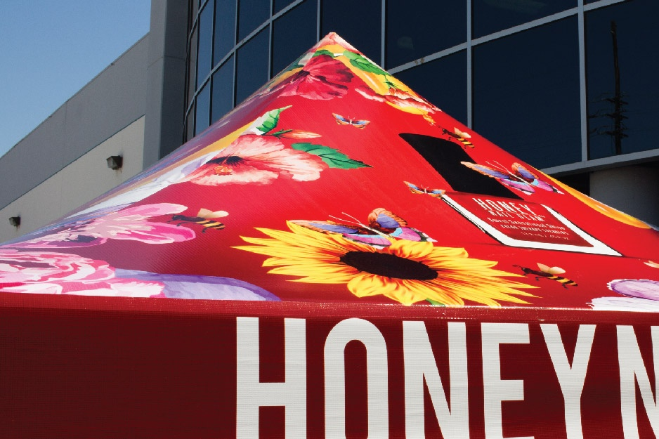 Red canopy tent top with colorful imagery