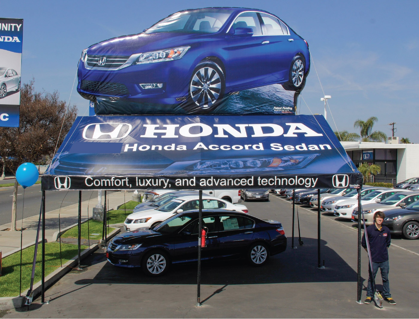 Honda Accord 20x20 Frame Tent with graphics printed on the tent with Honda slogans