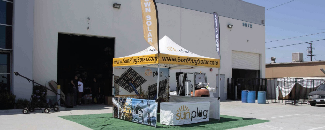 tent with printed canopy back wall, short walls, table cover, and advertising flags