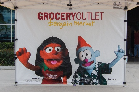Grocery outlet full back wall with a custom print of puppets on it