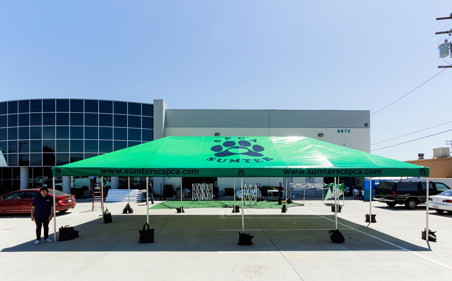 Sumpter SPCA Standard Frame Tent with green printing and a branded logo on the tent