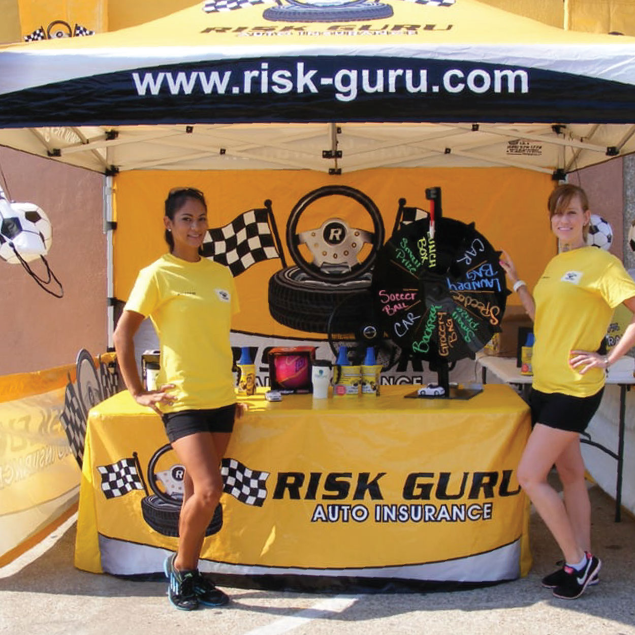 risk guru canopy flag tent with printed tent top, full wall, table cover, and short walls