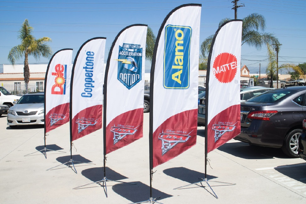 Disney's Cars 3 sponsors  listed on various advertising flags