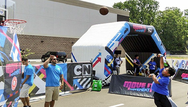 Cartoon Network Custom Printed Inflatable Tunnel Structure with kids playing around it