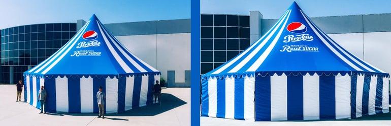 people-standing-next-to-hexagonal-tent.jpg