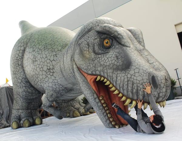giant-inflatable-dinosaur-eating-guy.jpg