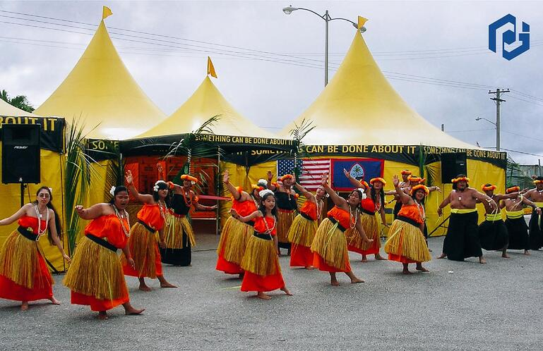 ceremonial-hula-dance-infront-of-three-octagonal-high-peak-tents