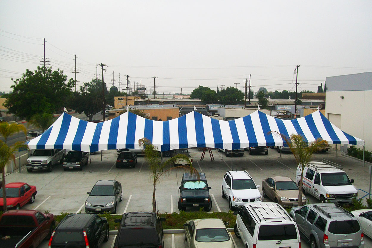 20x100-blue-white-striped-frame-tent-onsite