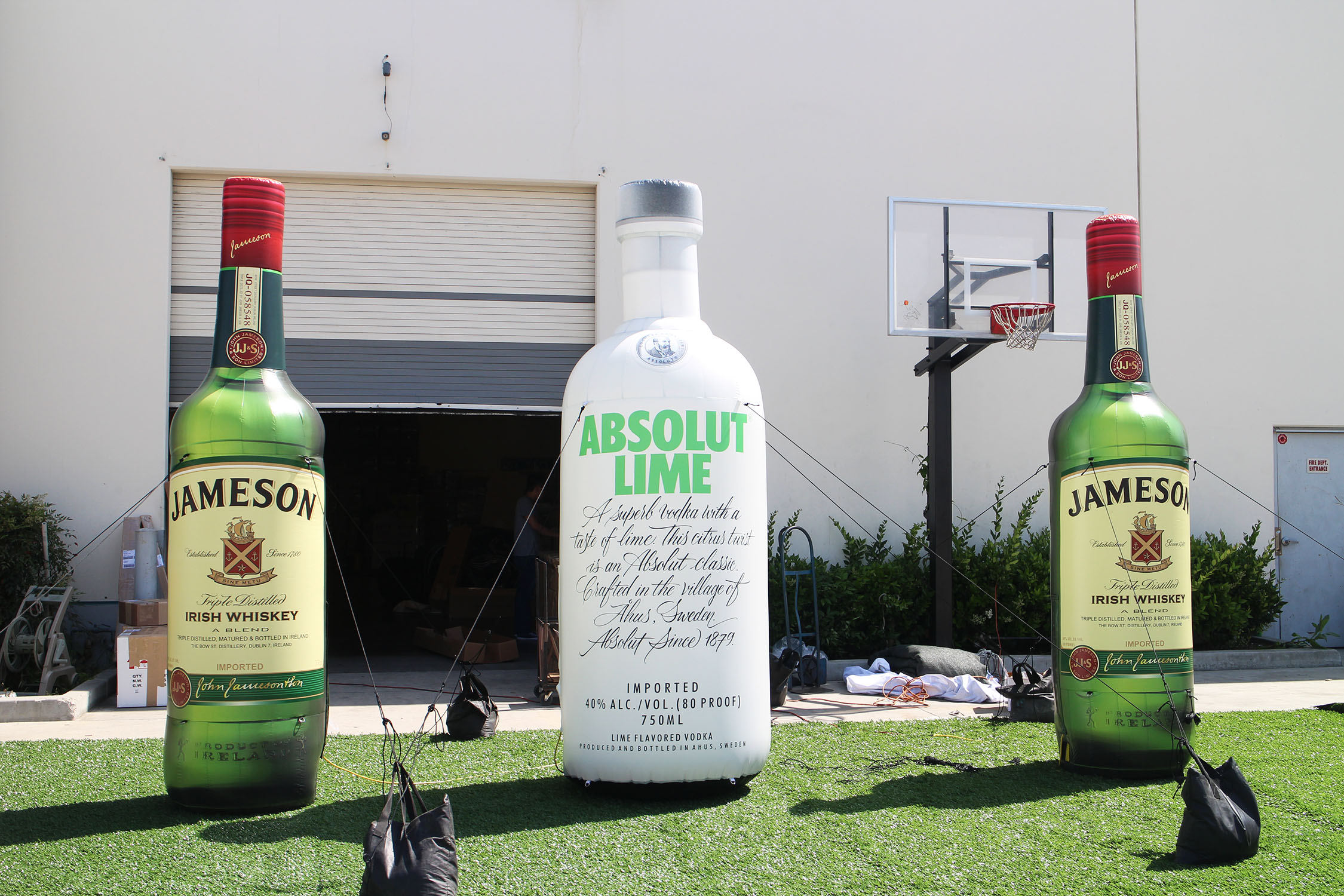inflatable-liquor-bottles-on-faux-grass