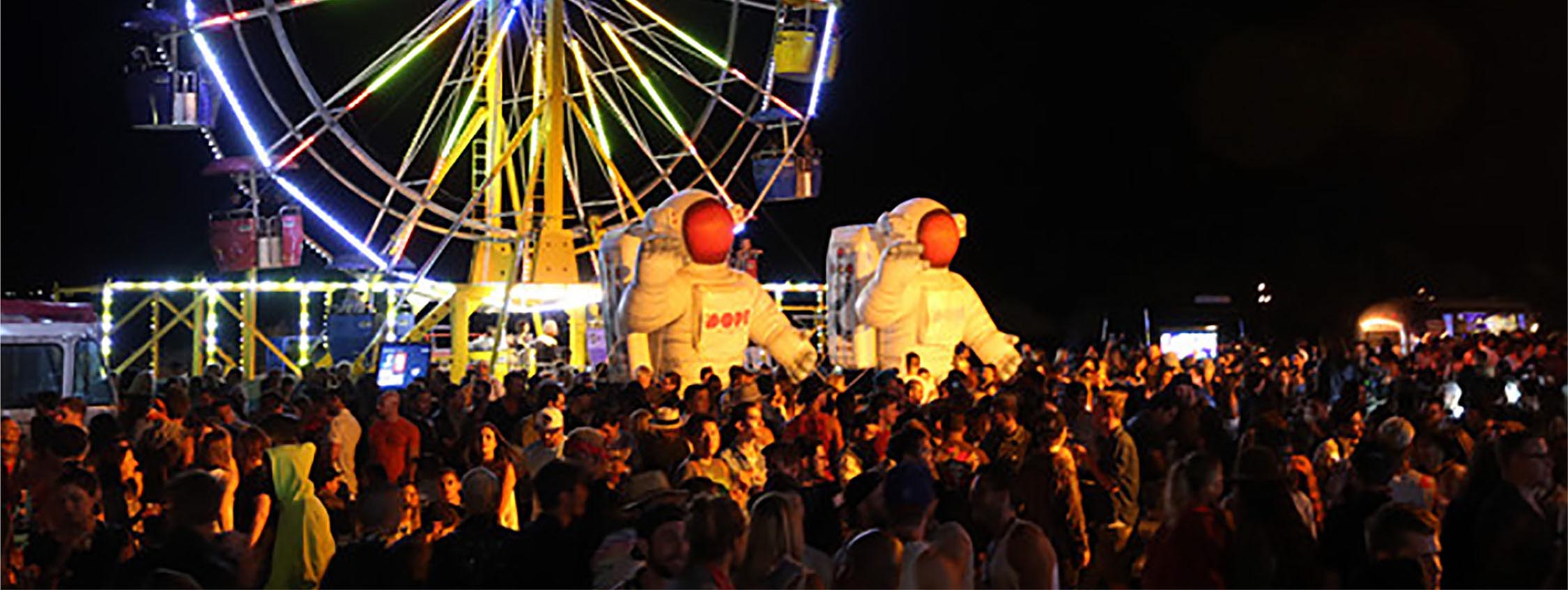 inflatable astronauts installed at a music festival as decorations