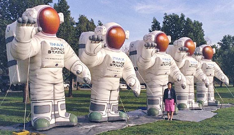 Multiple Inflatable Astronauts with the IMAX logo printed on their chest