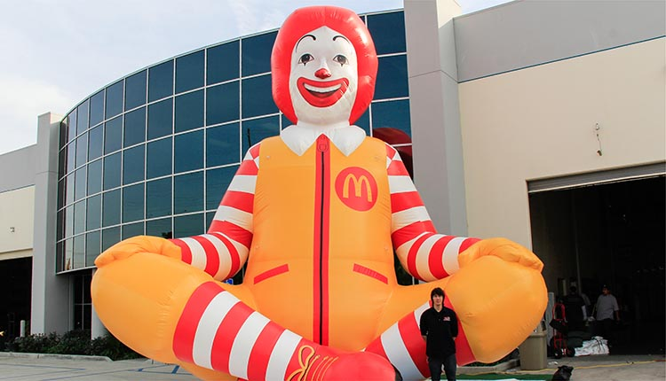 Inflatable 25 foot Ronald McDonald replica sitting outside the promotional design group building